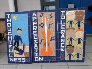 Three of twenty two murals created at Red Oaks Primary School.